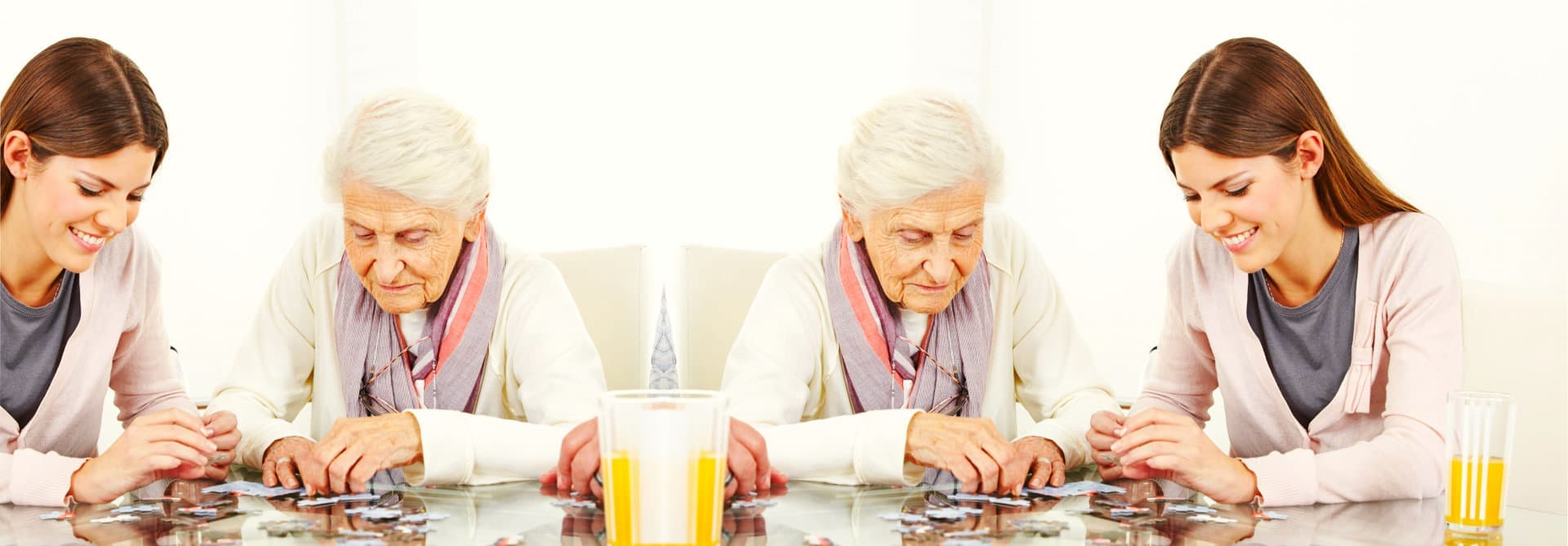young and old lady playing puzzle