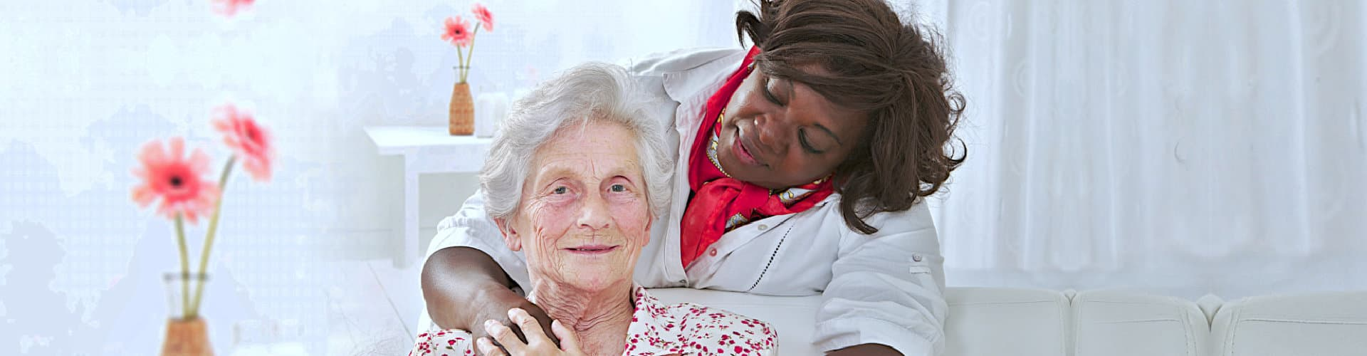 old lady smiling while her caregiver watching