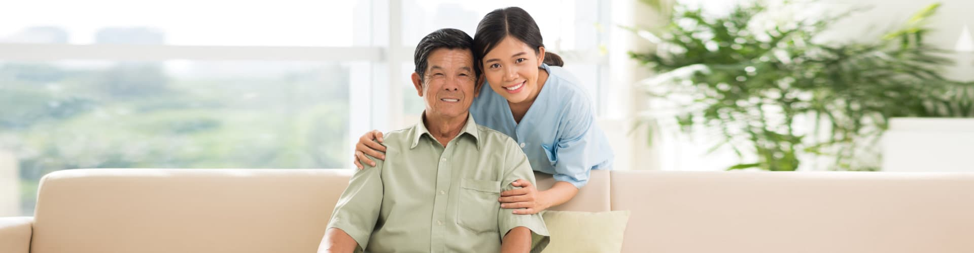 young caregiver and old man smiling
